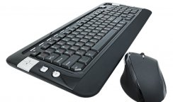 A multifunctional computer keyboard and mouse on white background